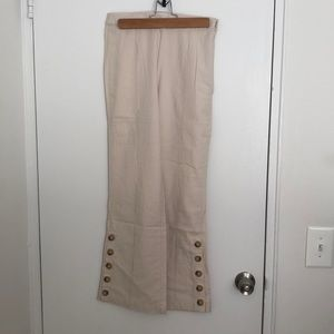 Bell bottom, buttoned, urban outfitter pants.